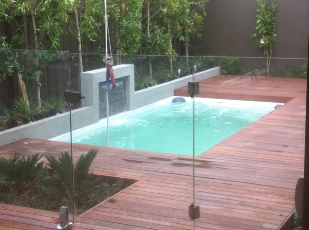 Swim spas plunge pools spa pools swimming pools portable spa pool plunge pool waterfall 1 freerunsca Image collections